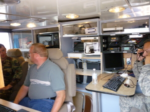 """Dino"" (right) Calling Camp Murray on HF from ACS Van; Ryan K7RGK demonstrating ACS gear."