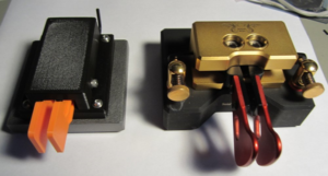 It's not a Begali Magnetic Pro (right), but the CW Morse dual-lever paddle (left) is worth considering as a first key.